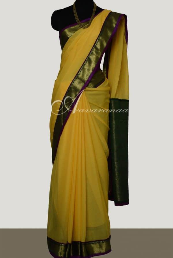 Yellow chiffon with green silk border saree-0