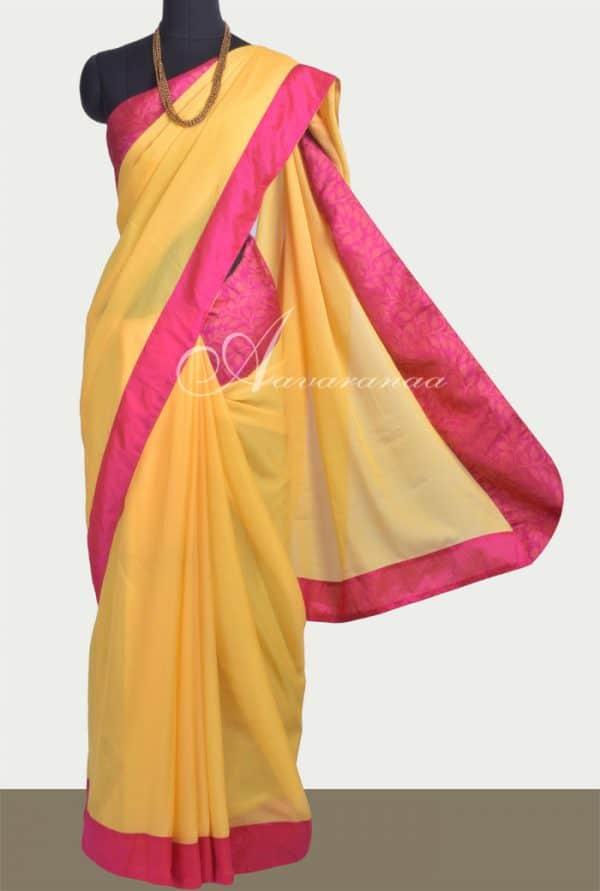 Yellow chiffon saree with pink silk border-0