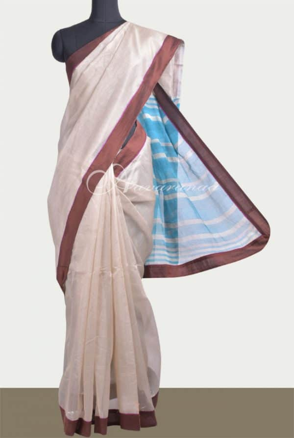 Beige Supernet saree with Blue leheriya pallu-0