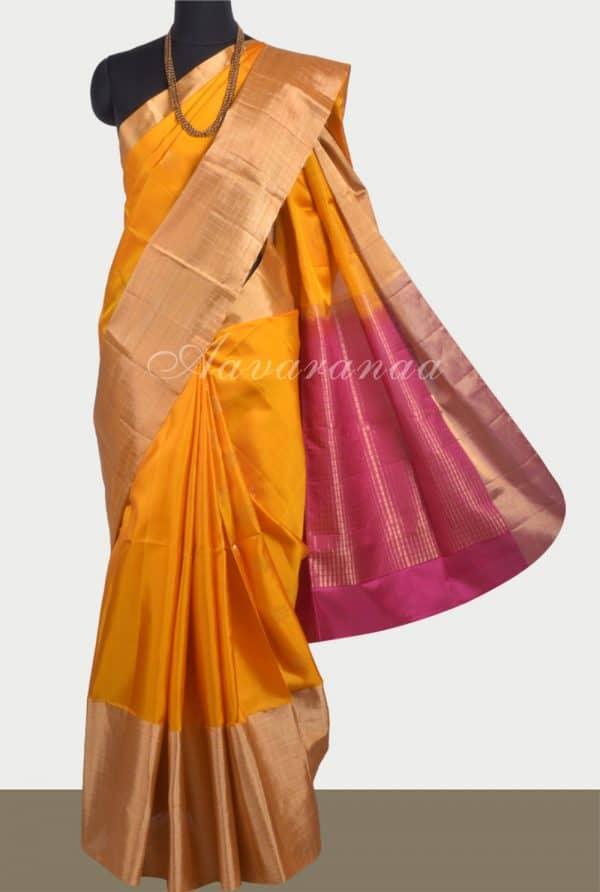 Plain yellow soft silk saree with zari border-0