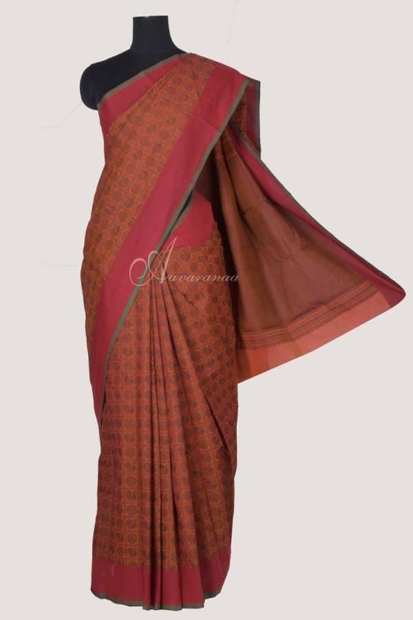 Rust orange kanchi cotton saree with black mayil chakram-0