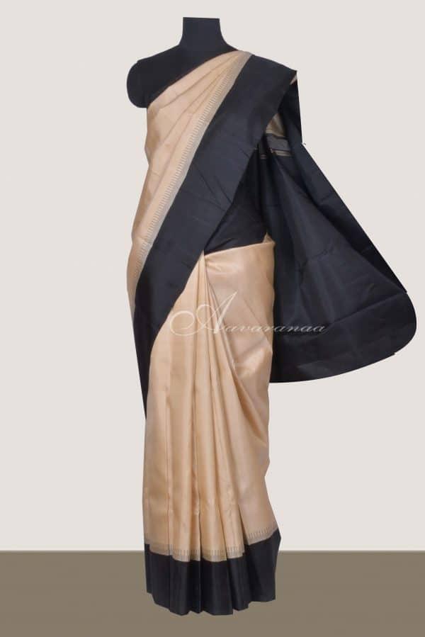 Cream kanchi silk saree with black korvai border-0