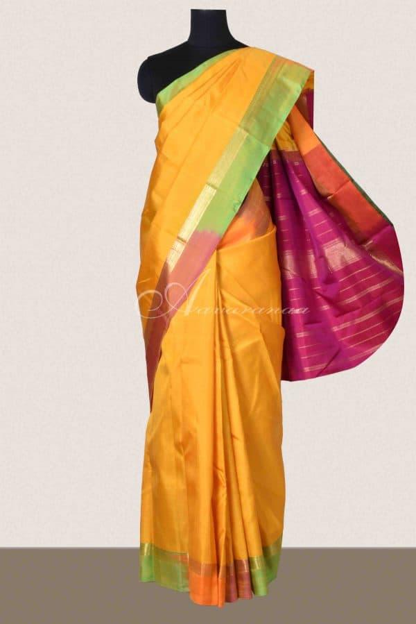 Yellow kanchi silk and multicoloured border saree-0