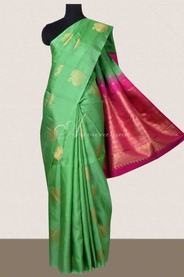Green kanchi silk saree with peacock motifs-0