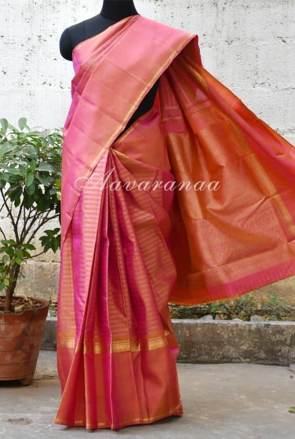 Peach kancheepuram silk saree with a rettai pattu border-0