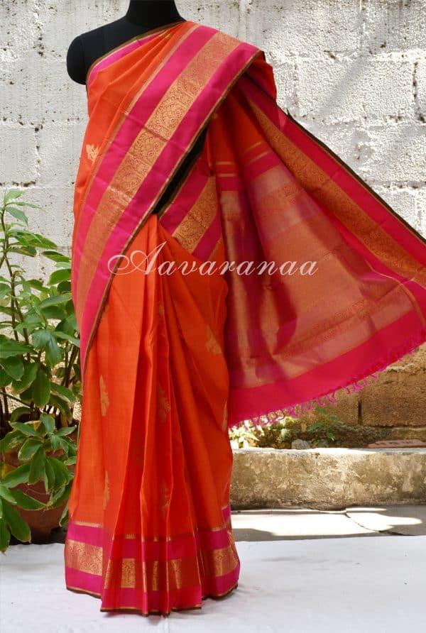 Orange kancheepuram silk saree with pink zari border -0