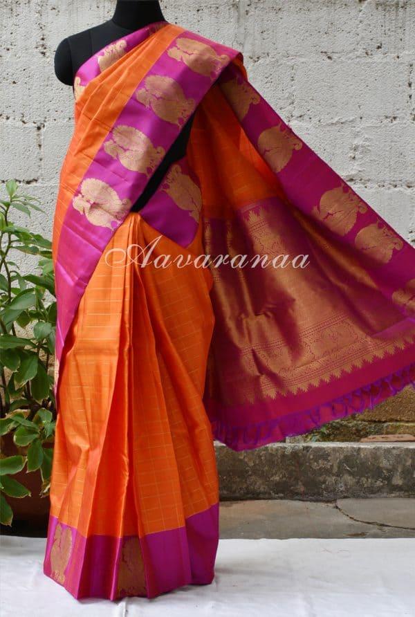 Orange zari checks kancheepuram silk saree with pink peacock border-0