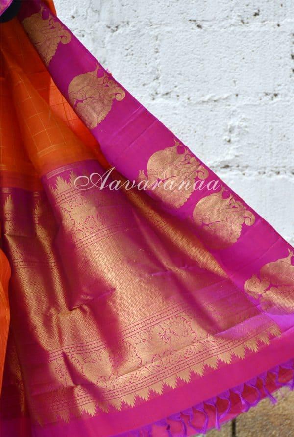 Orange zari checks kancheepuram silk saree with pink peacock border-18650