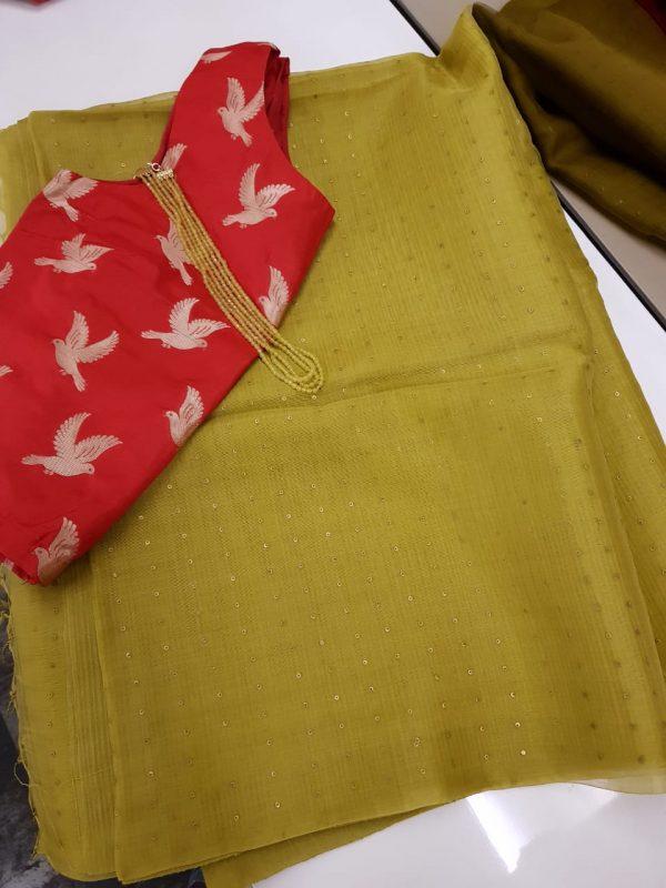 green woven organza saree