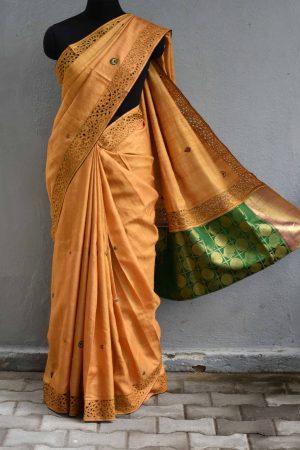 Mustard cutwork tussar saree with silk pallu