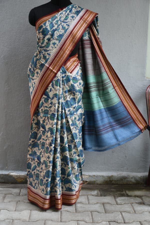 Beige and blue printed tussar saree with red border