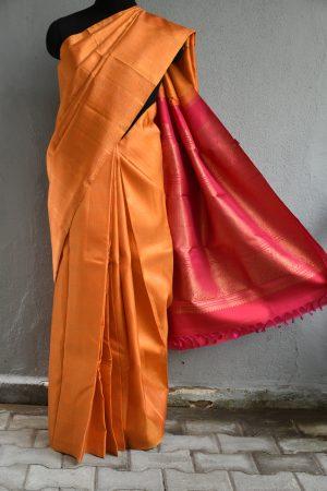 Orange kanchi silk saree with geometric zari design
