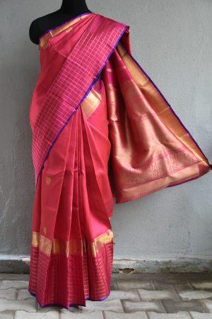 Pink and red kancheepuram silk saree with checks border