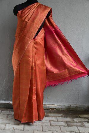 Red kanchi silk saree with geometric zari design