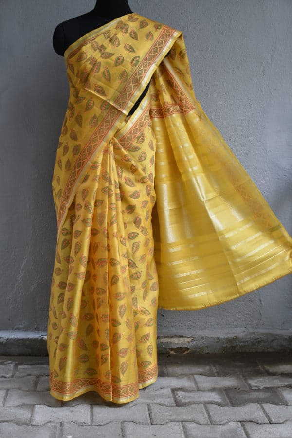 yellow organza kanchi silk saree with block print
