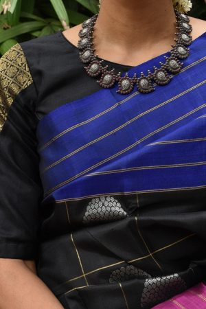 Black ready to wear kanchi silk blouse with mayilchakaram zari patch on the sleeves