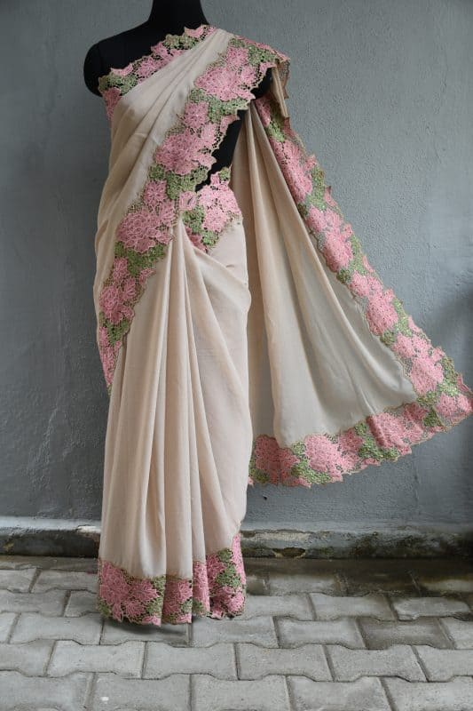 Cream chiffon saree with pink and green sequins cut work border