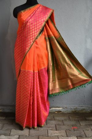 Orange and pink half an half kanchi silk saree with peacock zaei weave