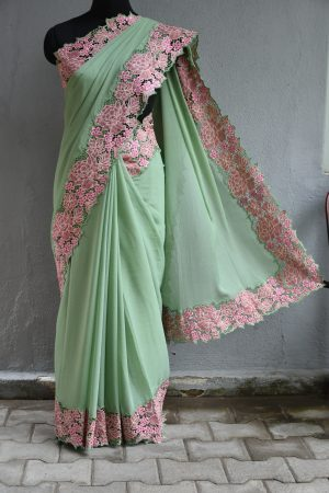 Pale green chiffon saree with pink sequins cut work border