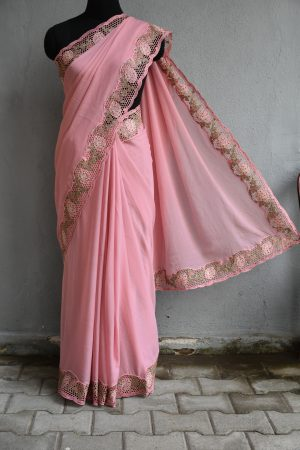 Pale pink chiffon saree with pink and green sequins cut work border