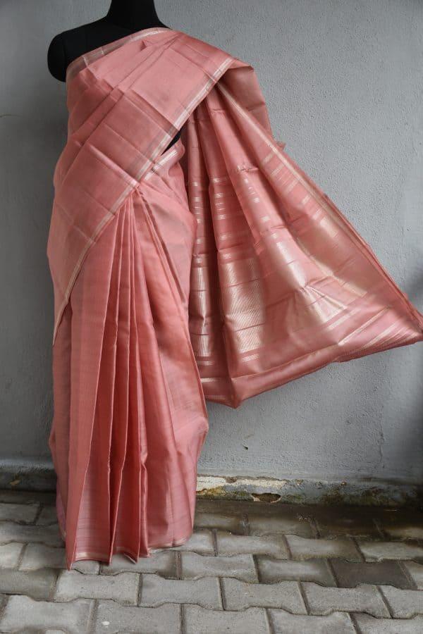 Plain pale pink organza kanchi silk saree with silver thin zari border and pallu