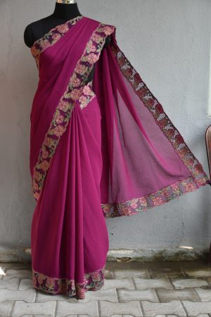 Purple chiffon saree with green sequins cut work border