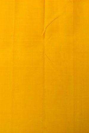 Cream and yellow one side long border kancheepuram silk saree blouse