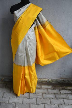 Cream and yellow one side long border kancheepuram silk saree1