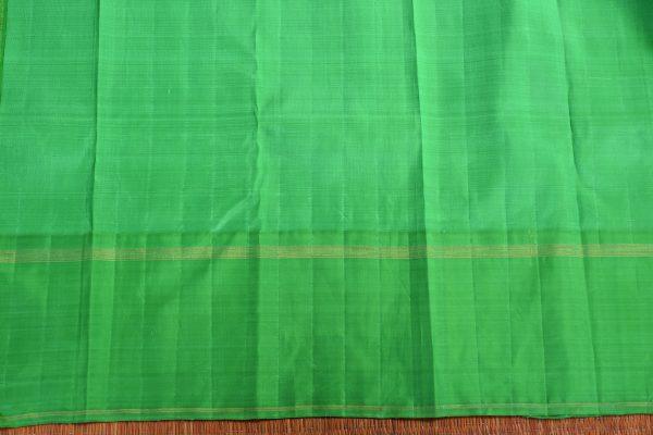 Cream zari stripes organza kancheepuram silk saree with green border blouse