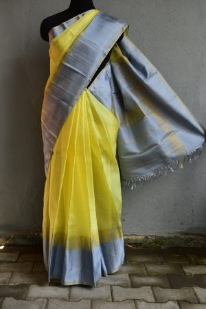 Lemon yellow organza kancheepuram silk saree with grey border