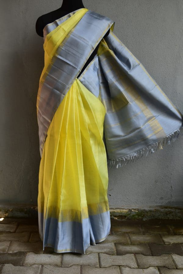 Lemon yellow organza kancheepuram silk saree with grey border
