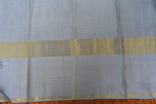 Lemon yellow organza kancheepuram silk saree with grey border blouse