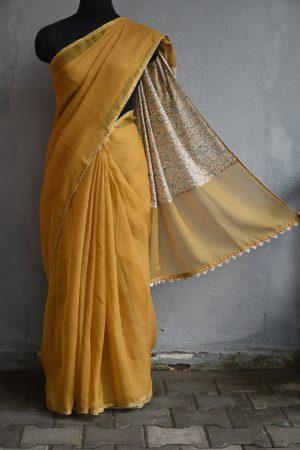 Mustard supernet saree with beige printed pallu