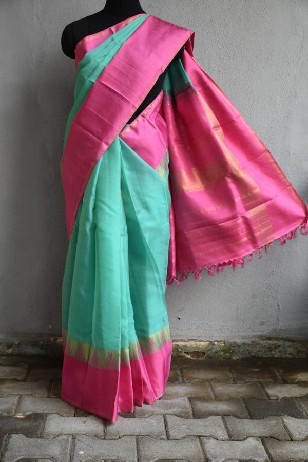 Saphire green organza kancheepuram saree with pink border