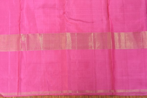 Saphire green organza kancheepuram saree with pink border blouse