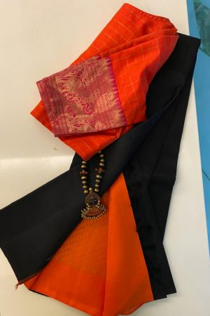 Black kanchipuram silk saree with orange pallu and blouse