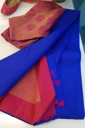 Blue plain kancheepuram silk saree with pink zari woven pallu