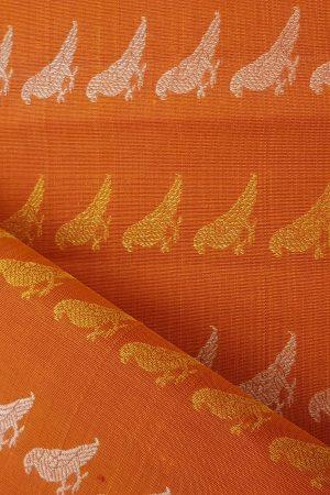 orange gold and silver bird design kanchi fabric