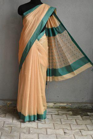 Beige chandheri saree with teal border 1