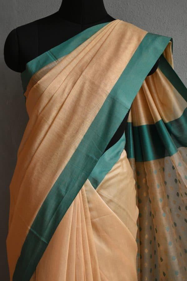 Beige chandheri saree with teal border 3