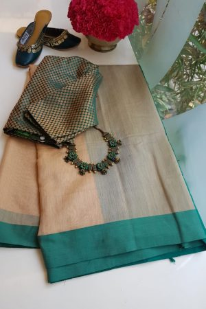 Beige chandheri saree with teal border