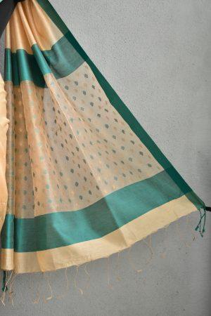 Beige chandheri saree with teal border 4
