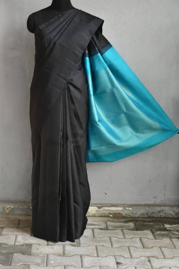 Black plain kanchi silk saree with teal rich pallu 1