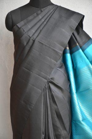 Black plain kanchi silk saree with teal rich pallu 3
