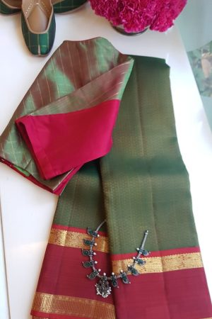 Bottle green brocade kancheepuram silk saree with red zari border