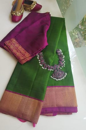 Green kancheepuram silk with magenta zari border