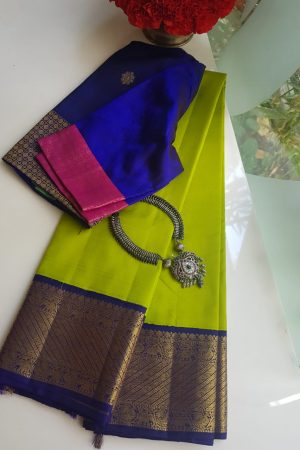 Green kanchi silk saree with blue korvai border
