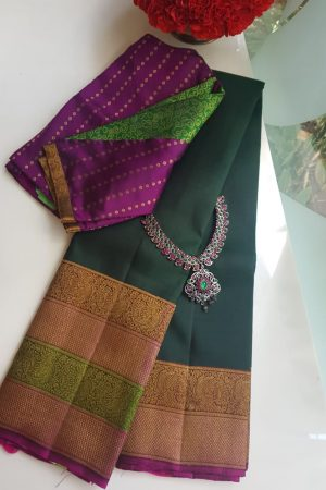 Green kanchi silk saree with pink border
