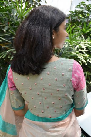 Pale green embroidered cotton blouse back