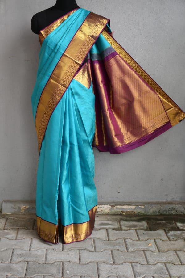 Turquoise blue kancheepuram silk saree with purple korvai border 1